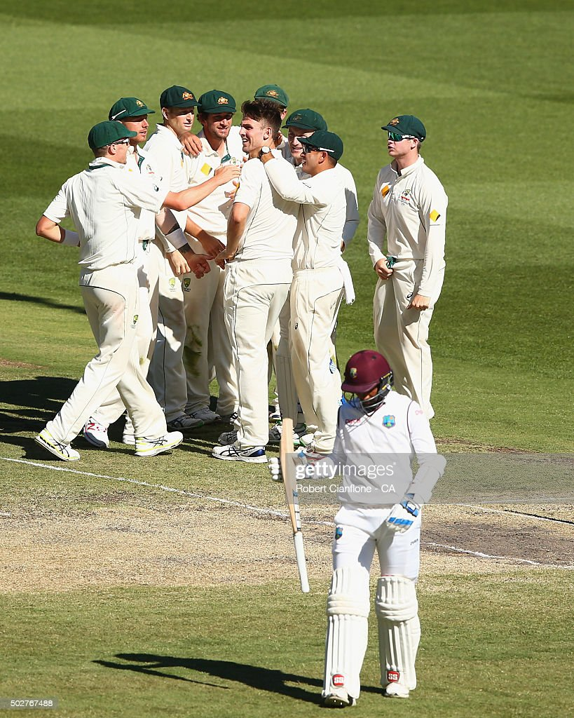 Mitch Marsh of Australia celebrates after taking the wicket of <a gi-track='captionPersonalityLinkClicked' href=/galleries/search?phrase=Denesh+Ramdin&family=editorial&specificpeople=542842 ng-click='$event.stopPropagation()'>Denesh Ramdin</a> of the West Indies during day four of the Second Test match between Australia and the West Indies at the Melbourne Cricket Ground on December 29, 2015 in Melbourne, Australia.
