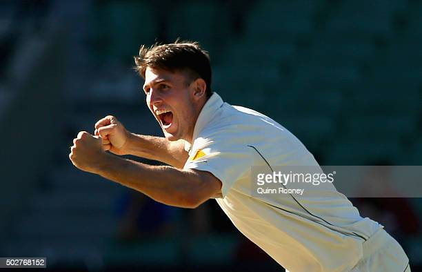 Mitch Marsh of Australia celebrates getting the final wicket and winning the match during day four of the Second Test match between Australia and the...