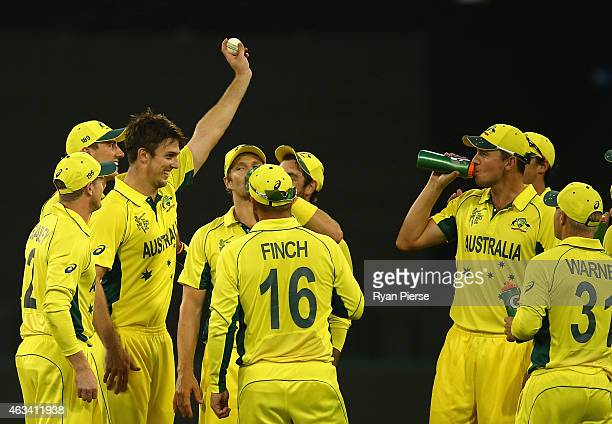 Mitch Marsh of Australia holds the ball aloft after claming his fifth wicket during the 2015 ICC Cricket World Cup match between England and...