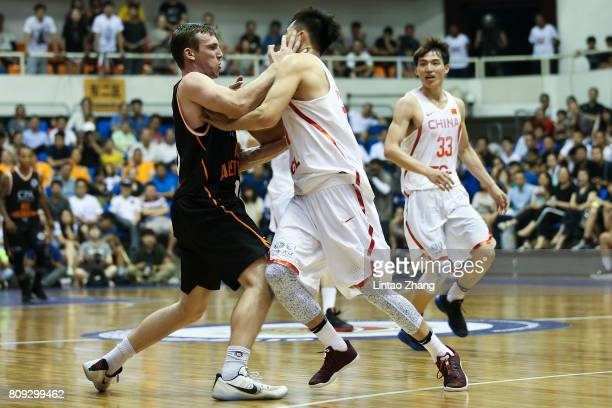 Mitch McCarron of Australia looks to pass against Zeng Lingxu of China during the 2017 SinoAustralia Men's International Basketball Challenge at...
