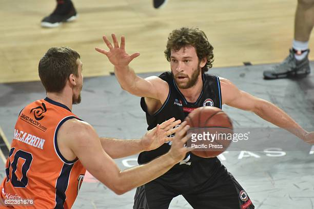 Mitch Mccarron of Taipans completes the ball against Isiah Tueta of Breakers during the round six NBL match between the New Zealand Breakers and the...