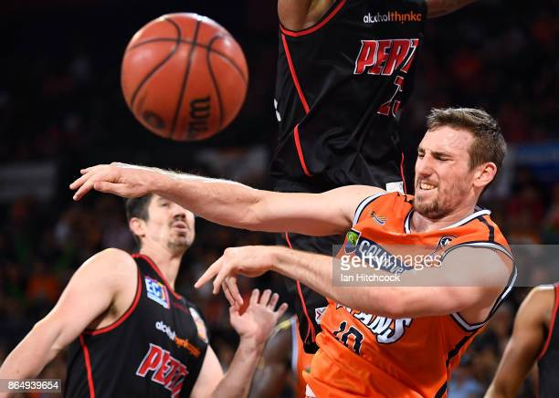 Mitch McCarron of the Taipans passes the ball during the round three NBL match between the Cairns Taipans and the Perth Wildcats at Cairns Convention...