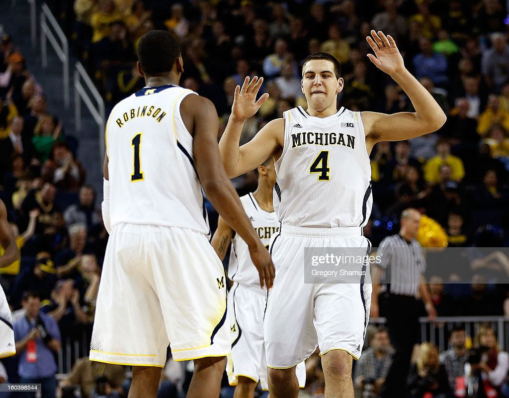 Mitch McGary #4 of the Michigan Wolverines and Glenn Robinson III #1 celebrate during the second half while playing the Northwestern Wildcats at Crisler Center on January 30, 2013 in Ann Arbor, Michigan. Michigan won the game 68-46.