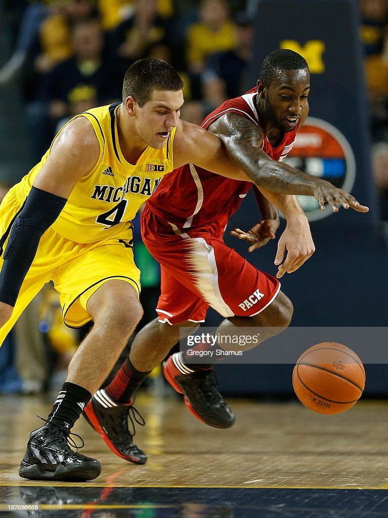 Mitch McGary #4 of the Michigan Wolverines battles for the ball with C.J. Leslie #5 of the North Carolina State Wolfpack during the second half at Crisler Center on November 27, 2012 in Ann Arbor, Michigan. Michigan won the game 79-72.