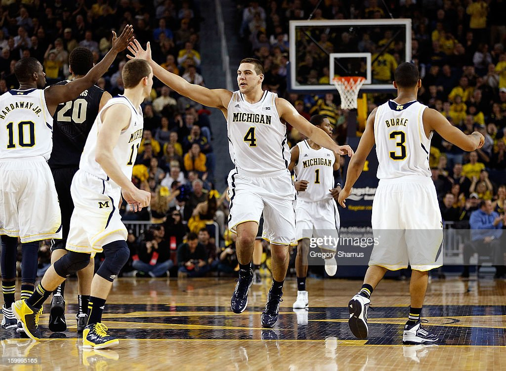 Mitch McGary #4 of the Michigan Wolverines celebrates a second half dunk with Trey Burke #3, Nik Stauskas #11 and Tim Hardaway Jr. #10 while playing the Purdue Boilermakers at Crisler Center on January 24, 2013 in Ann Arbor, Michigan. Michigan won the game 68-53.
