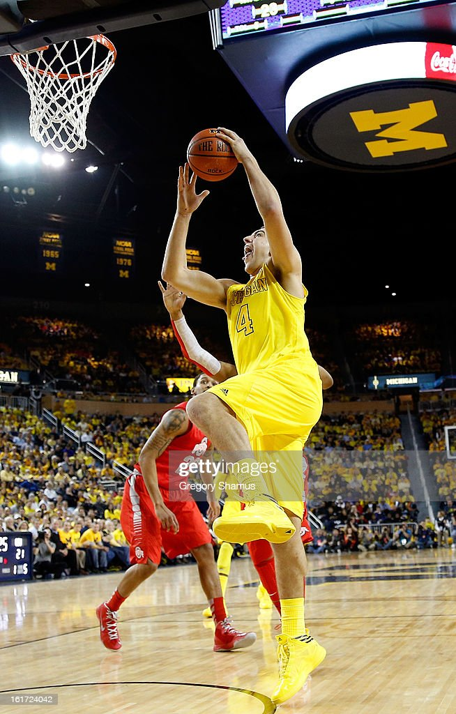 Mitch McGary #4 of the Michigan Wolverines goes in for two points against the Ohio State Buckeyes at Crisler Center on February 5, 2013 in Ann Arbor, Michigan. Michigan won the game 76-74 in overtime.