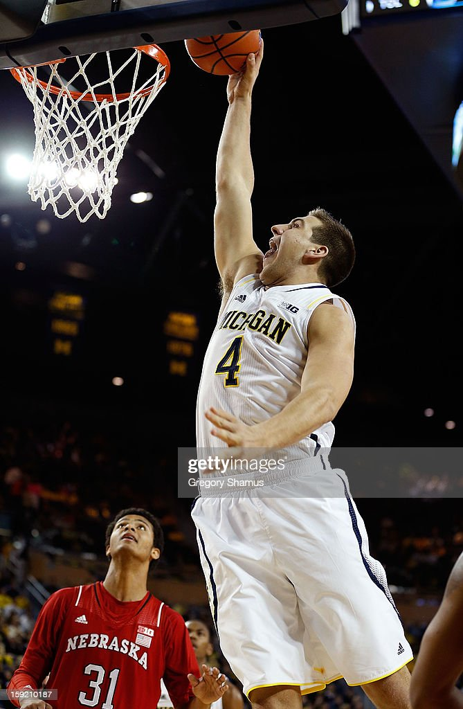 Mitch McGary #4 of the Michigan Wolverines misses a dunk as Shavon Shields #31 of the Nebraska Cornhuskers looks on at Crisler Center on January 9, 2013 in Ann Arbor, Michigan.
