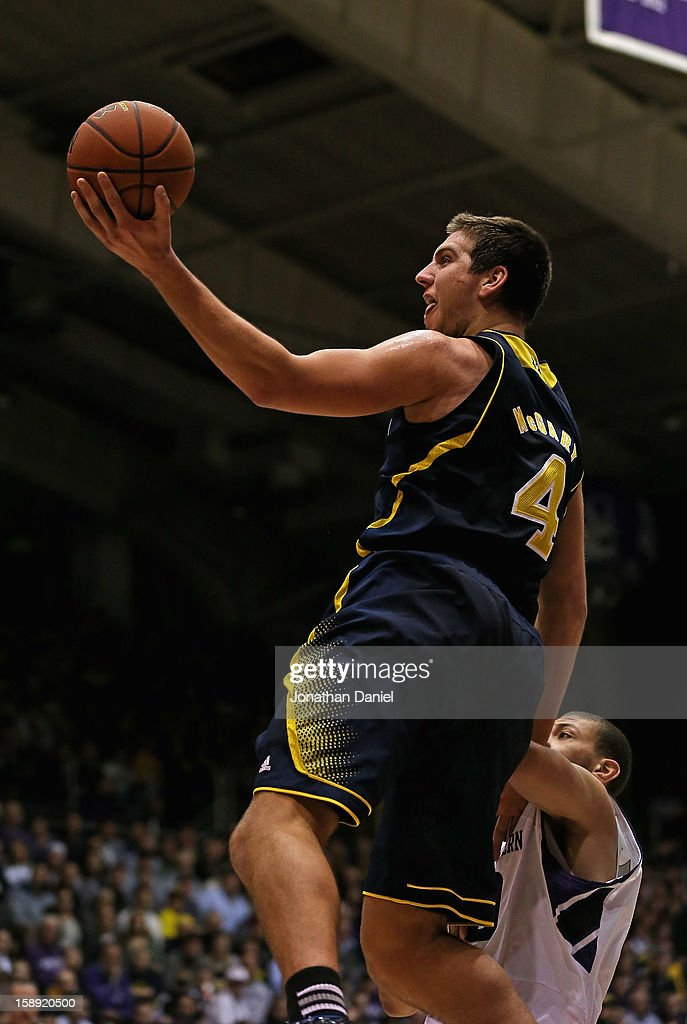 Mitch McGary #4 of the Michigan Wolverines puts up a shot over Mike Turner #10 of the Northwestern Wildcats at Welsh-Ryan Arena on January 3, 2013 in Evanston, Illinois. Michigan defeated Northwestern 94-66.