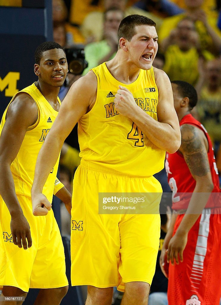 Mitch McGary #4 of the Michigan Wolverines reacts after a basket while playing the Ohio State Buckeyes in the second half at Crisler Center on February 5, 2013 in Ann Arbor, Michigan. Michigan won the game 76-74 in overtime.