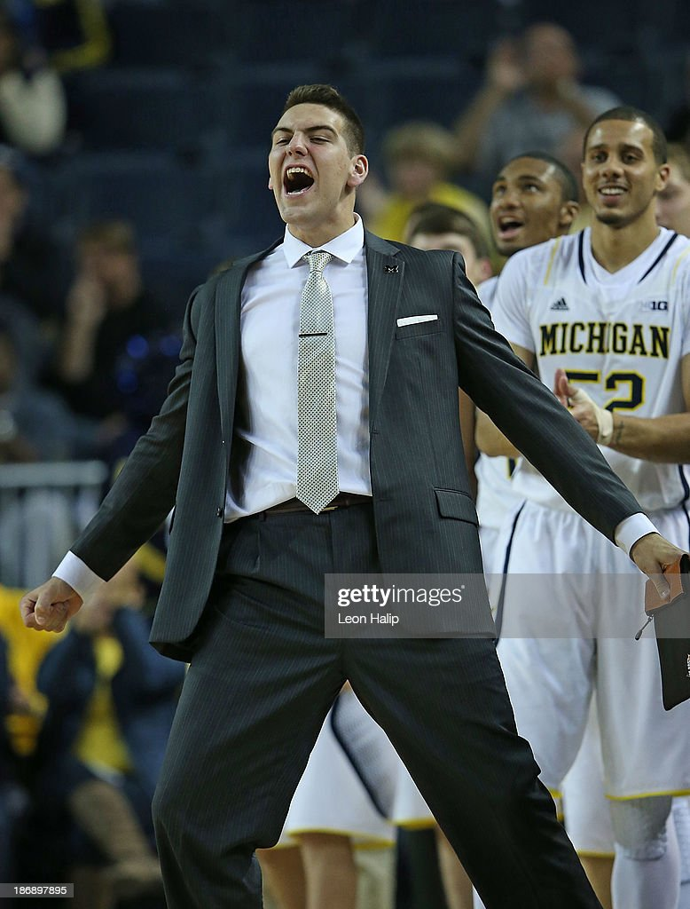 <a gi-track='captionPersonalityLinkClicked' href=/galleries/search?phrase=Mitch+McGary&family=editorial&specificpeople=7887132 ng-click='$event.stopPropagation()'>Mitch McGary</a> #4 of the Michigan Wolverines reacts on the sidelines to a big play during the first half of the game against the Wayne State Warriors at Crisler Center on November 4, 2013 in Ann Arbor, Michigan. Michigan defeated Wayne State 79-60.