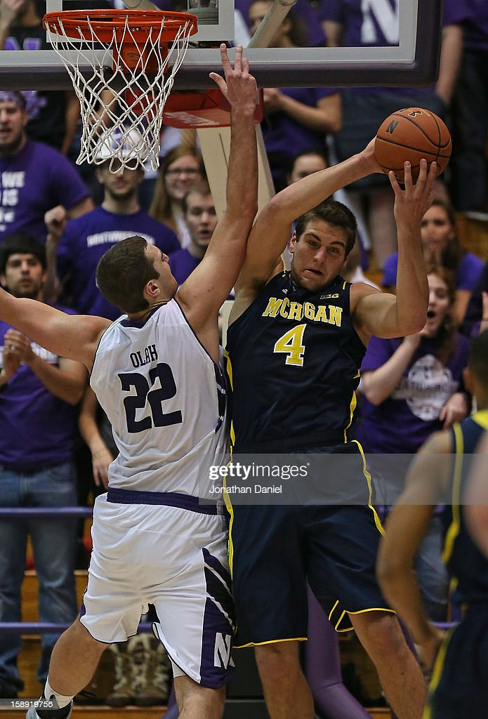 Mitch McGary #4 of the Michigan Wolverines rebounds over Alex Olah #22 of the Northwestern Wildcats at Welsh-Ryan Arena on January 3, 2013 in Evanston, Illinois. Michigan defeated Northwestern 94-66.