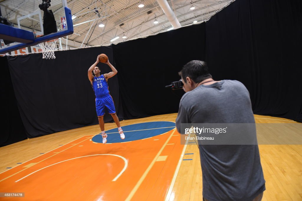 <a gi-track='captionPersonalityLinkClicked' href=/galleries/search?phrase=Mitch+McGary&family=editorial&specificpeople=7887132 ng-click='$event.stopPropagation()'>Mitch McGary</a> #33 of the Oklahoma City Thunder behind the scenes during the 2014 NBA rookie photo shoot on August 3, 2014 at the Madison Square Garden Training Facility in Tarrytown, New York.