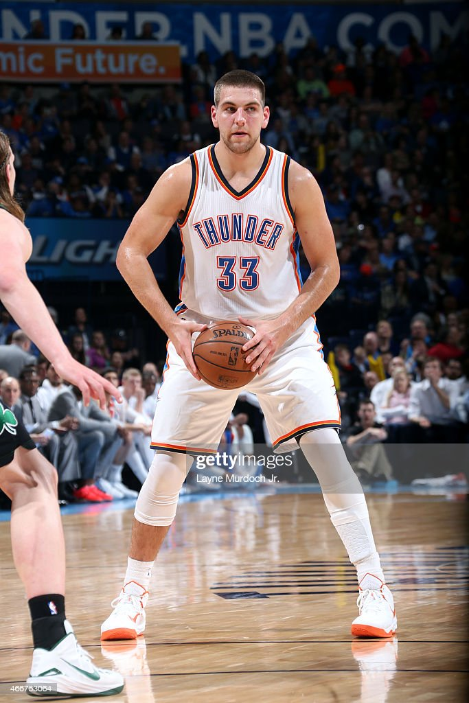 <a gi-track='captionPersonalityLinkClicked' href=/galleries/search?phrase=Mitch+McGary&family=editorial&specificpeople=7887132 ng-click='$event.stopPropagation()'>Mitch McGary</a> #33 of the Oklahoma City Thunder handles the ball against the Boston Celtics on March 18, 2015 at the Chesapeake Energy Arena in Oklahoma City, Oklahoma.
