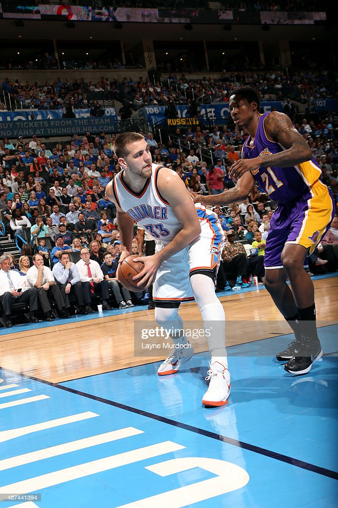<a gi-track='captionPersonalityLinkClicked' href=/galleries/search?phrase=Mitch+McGary&family=editorial&specificpeople=7887132 ng-click='$event.stopPropagation()'>Mitch McGary</a> #33 of the Oklahoma City Thunder handles the ball against the Los Angeles Lakers on March 24, 2014 at Chesapeake Energy Arena in Oklahoma City, OK.