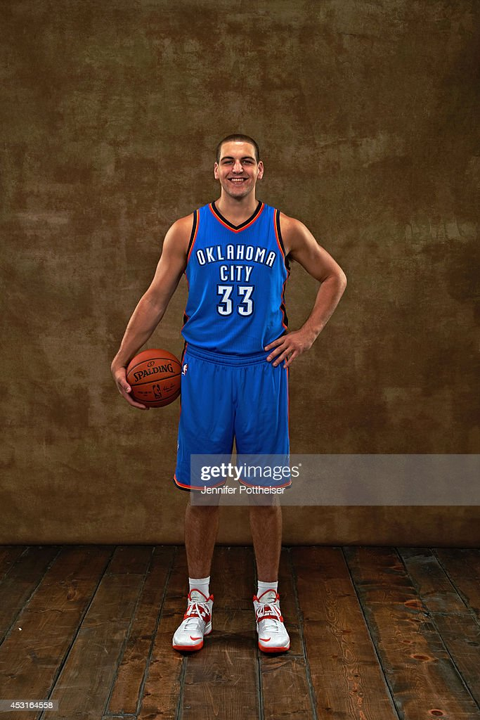 <a gi-track='captionPersonalityLinkClicked' href=/galleries/search?phrase=Mitch+McGary&family=editorial&specificpeople=7887132 ng-click='$event.stopPropagation()'>Mitch McGary</a> #33 of the Oklahoma City Thunder pose for a portrait during the 2014 NBA rookie photo shoot on August 3, 2014 at the Madison Square Garden Training Facility in Tarrytown, New York.