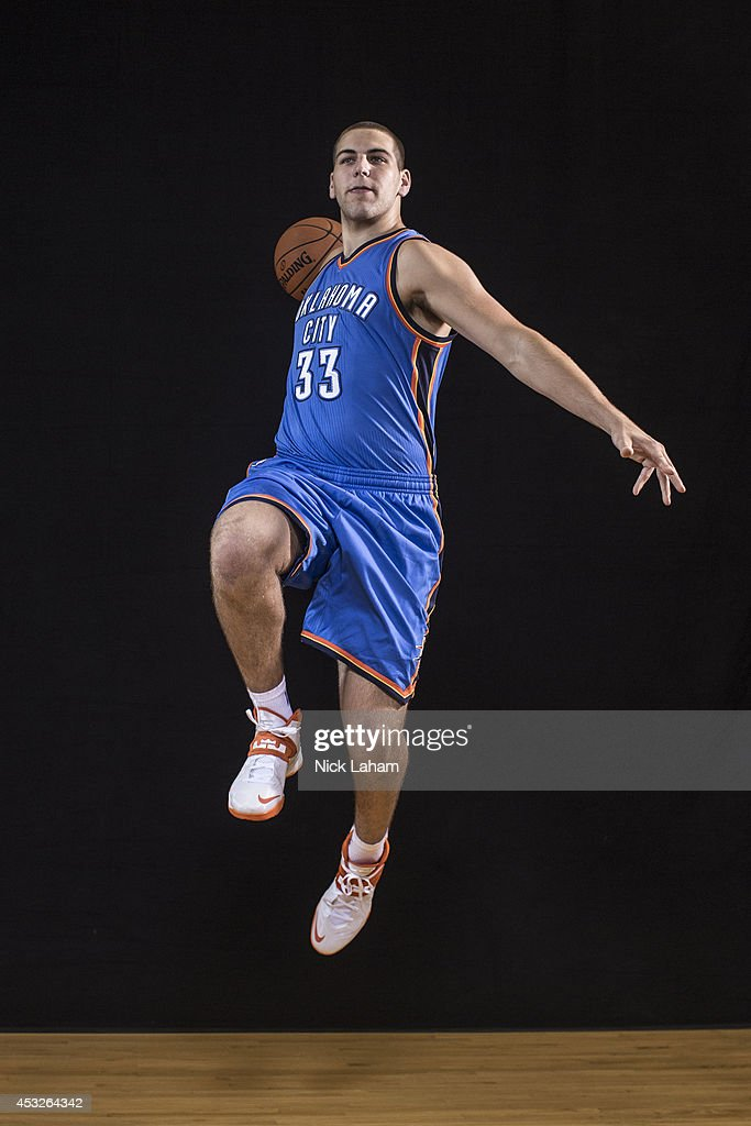 <a gi-track='captionPersonalityLinkClicked' href=/galleries/search?phrase=Mitch+McGary&family=editorial&specificpeople=7887132 ng-click='$event.stopPropagation()'>Mitch McGary</a> #33 of the Oklahoma City Thunder pose for a portrait during the 2014 NBA rookie photo shoot at MSG Training Center on August 3, 2014 in Tarrytown, New York.