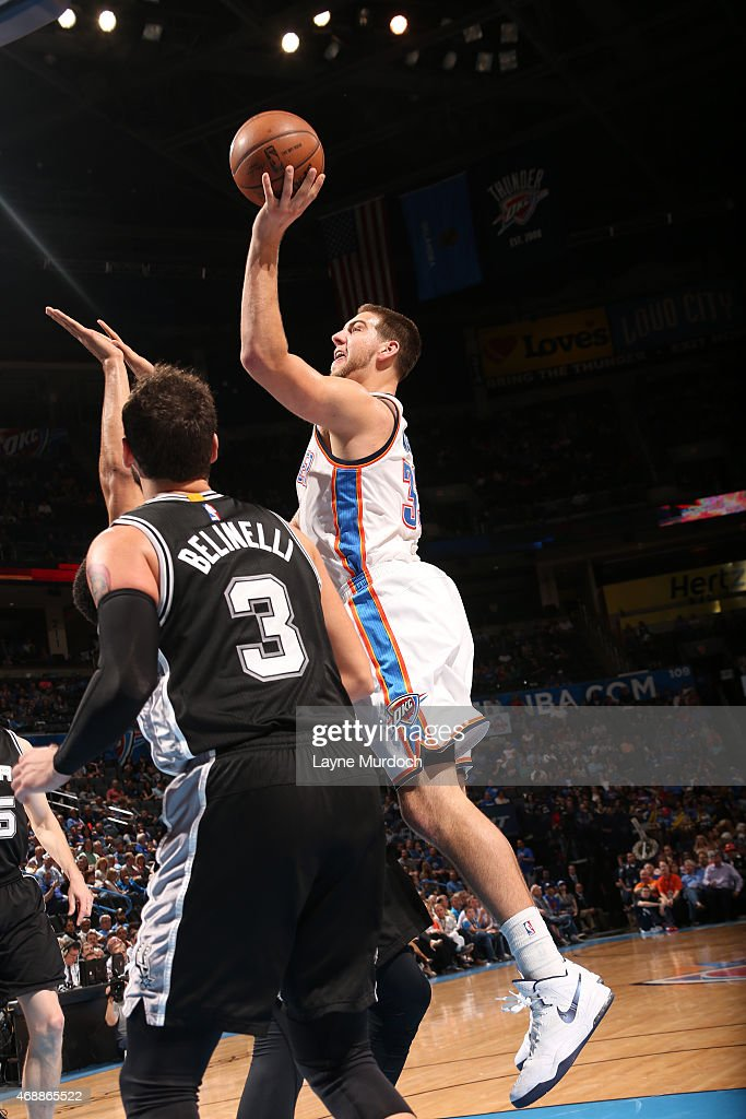 Mitch McGary #33 of the Oklahoma City Thunder shoots the ball against the San Antonio Spurs on April 7, 2015 at Chesapeake Energy Arena in Oklahoma City, Oklahoma.