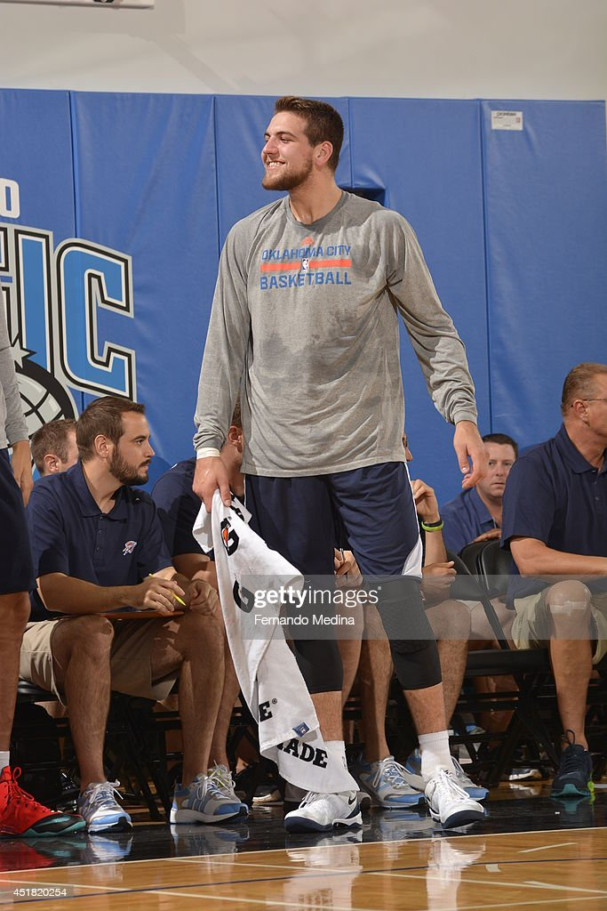 <a gi-track='captionPersonalityLinkClicked' href=/galleries/search?phrase=Mitch+McGary&family=editorial&specificpeople=7887132 ng-click='$event.stopPropagation()'>Mitch McGary</a> #33 of the Oklahoma City Thunder smiles during the game against the Brooklyn Nets during the Samsung NBA Summer League 2014 on July 7, 2014 at Amway Center in Orlando, Florida.