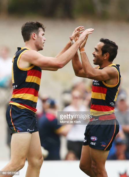 Mitch McGovern and Eddie Betts of the Crows celebrates a goal by McGovern during the JLT Community Series AFL match between the Adelaide Crows and...