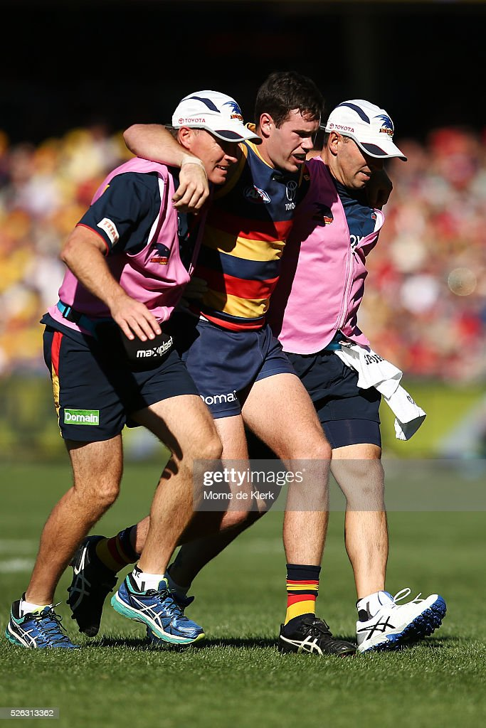 Mitch McGovern of the Crows is helped from the field after getting injured during the round six AFL match between the Adelaide Crows and the Fremantle Dockers at Adelaide Oval on April 30, 2016 in Adelaide, Australia.