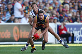 Mitch McGovern of the Crows is tackled by Cameron Sutcliffe Fremantle during the 2016 AFL Round 06 match between the Adelaide Crows and the Fremantle...