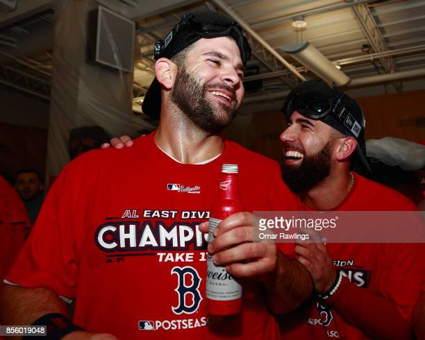 Mitch Moreland and Deven Marrero of the Boston Red Sox celebrate after winning the AL East Division at Fenway Park on September 30 2017 in Boston...