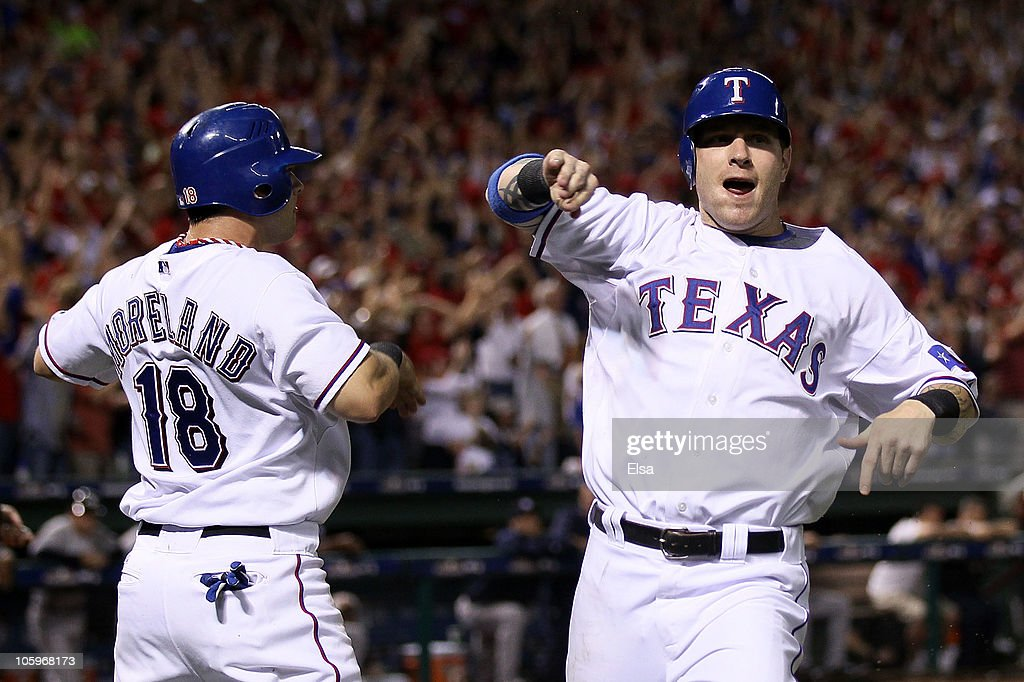 <a gi-track='captionPersonalityLinkClicked' href=/galleries/search?phrase=Mitch+Moreland&family=editorial&specificpeople=6824046 ng-click='$event.stopPropagation()'>Mitch Moreland</a> #18 and <a gi-track='captionPersonalityLinkClicked' href=/galleries/search?phrase=Josh+Hamilton&family=editorial&specificpeople=234355 ng-click='$event.stopPropagation()'>Josh Hamilton</a> #32 of the Texas Rangers celebrate after they scored on a 2-run double by Vladimir Guerrero #27 ini the bottom of the fifth inning against the New York Yankees in Game Six of the ALCS during the 2010 MLB Playoffs at Rangers Ballpark in Arlington on October 22, 2010 in Arlington, Texas.