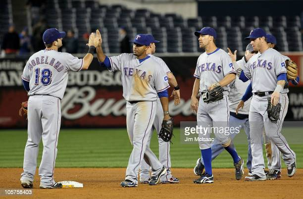 Mitch Moreland Nelson Cruz David Murphy and Josh Hamilton of the Texas Rangers celebrate after the Rangers won 103 against the New York Yankees in...