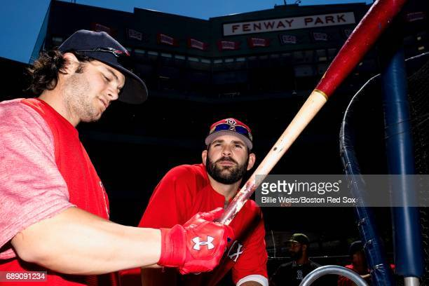 Mitch Moreland of the Boston Red Sox and Andrew Benintendi take batting practice before a game against the Seattle Mariners on May 27 2017 at Fenway...