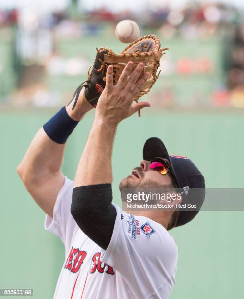 Mitch Moreland of the Boston Red Sox catches a pop fly against the New York Yankees in the fifth inning at Fenway Park on August 20 2017 in Boston...