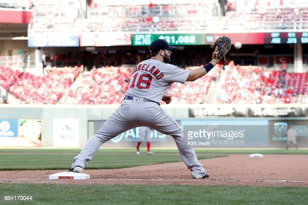 Mitch Moreland of the Boston Red Sox catches the ball at first base during the game against the Cincinnati Reds at Great American Ball Park on...