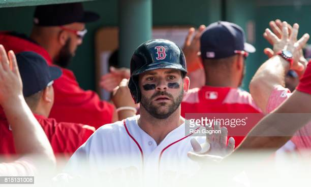 Mitch Moreland of the Boston Red Sox celebrates after he drove in the first run of the game during the third inning of a game against the New York...