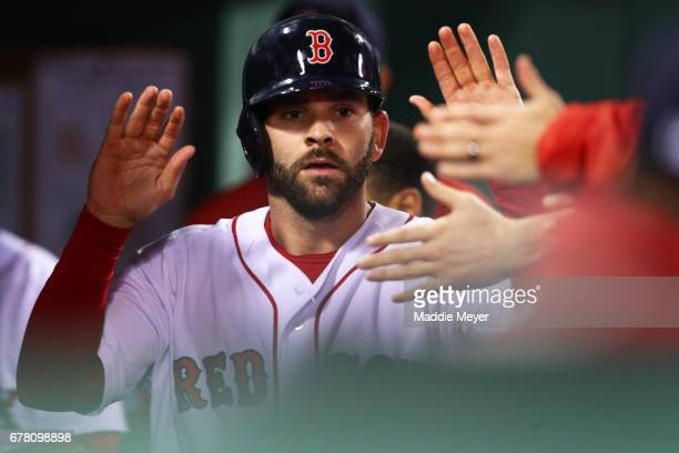 Mitch Moreland of the Boston Red Sox celebrates in the dugout after scoring a run against the Baltimore Orioles during the fourth inning at Fenway...