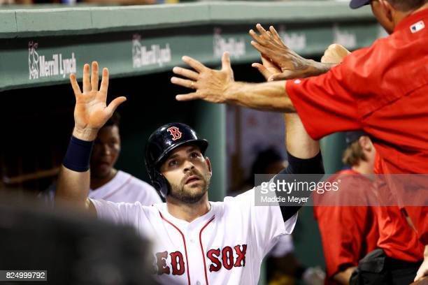 Mitch Moreland of the Boston Red Sox celebrates in the dugout after scoring a run against the Cleveland Indians during the fourth inning at Fenway...
