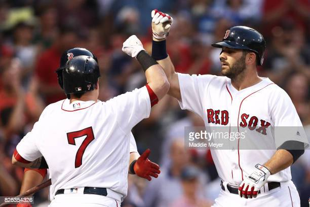 Mitch Moreland of the Boston Red Sox celebrates with Christian Vazquez after hitting a three run homer during the second inning at Fenway Park on...