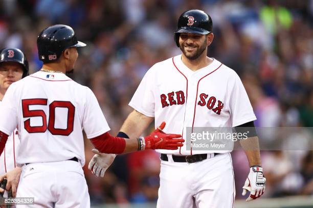 Mitch Moreland of the Boston Red Sox celebrates with Mookie Betts after hitting a three run homer during the second inning at Fenway Park on August 1...