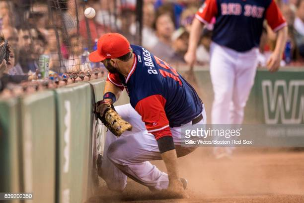 Mitch Moreland of the Boston Red Sox crashes into the wall as he attempts to catch a foul ball during the second inning of a game against the...