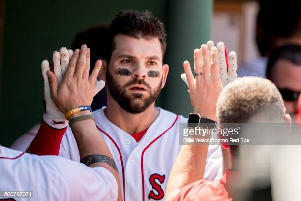 Mitch Moreland of the Boston Red Sox high fives teammates after hitting a solo home run during the second inning of a game against the Los Angeles...