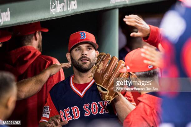 Mitch Moreland of the Boston Red Sox high fives teammates after pitching during the ninth inning of a game against the Baltimore Orioles on August 25...