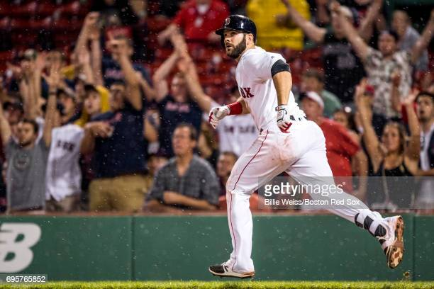 Mitch Moreland of the Boston Red Sox hits a single during the twelfth inning of a game against the Philadelphia Phillies on June 13 2017 at Fenway...