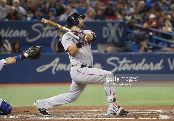 Mitch Moreland of the Boston Red Sox hits a tworun home run in the seventh inning during MLB game action against the Toronto Blue Jays at Rogers...