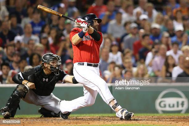 Mitch Moreland of the Boston Red Sox hits a walk off solo home run in the eleventh inning of a game against the Chicago White Sox at Fenway Park on...