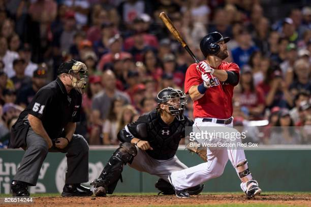 Mitch Moreland of the Boston Red Sox hits a walkoff solo home run during the eleventh inning of a game against the Chicago White Sox on August 4 2017...