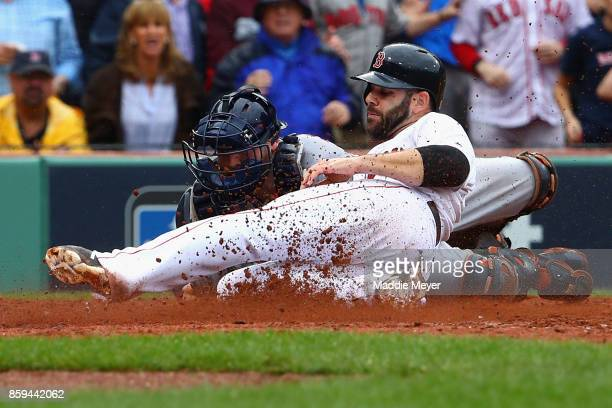 Mitch Moreland of the Boston Red Sox is tagged out at home plate by Brian McCann of the Houston Astros to end the third inning during game four of...