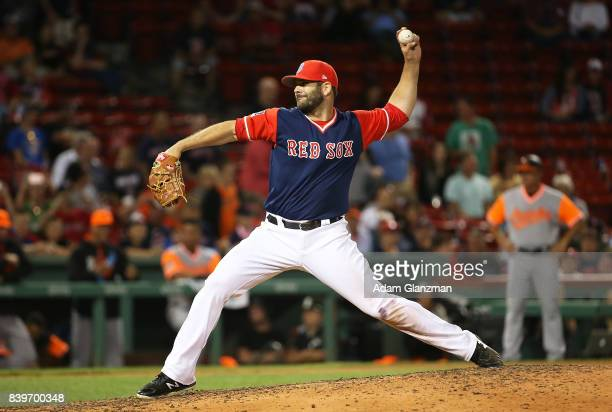 Mitch Moreland of the Boston Red Sox pitches in the ninth inning of a game against the Baltimore Orioles at Fenway Park on August 25 2017 in Boston...