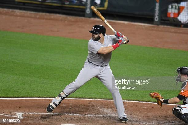 Mitch Moreland of the Boston Red Sox prepares for a pitch during a baseball game against the Baltimore Orioles at Oriole Park at Camden Yards on June...
