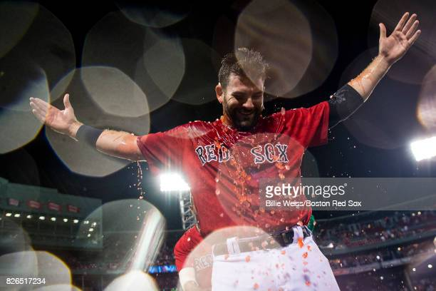 Mitch Moreland of the Boston Red Sox reacts after being doused with Powerade after hitting a walkoff solo home run during the eleventh inning of a...