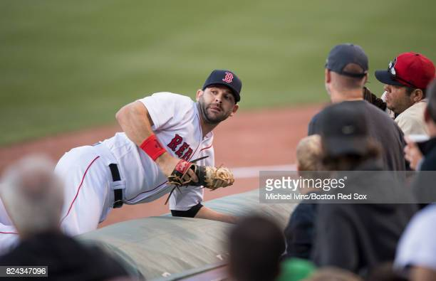 Mitch Moreland of the Boston Red Sox reacts after catching a foul ball against the Kansas City Royals in the first inning on July 29 2017 in Boston...