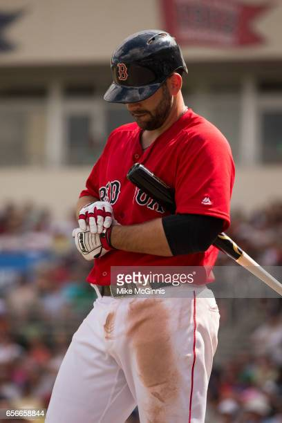 Mitch Moreland of the Boston Red Sox tightens his Franklin batting gloves during the spring Training game against the Team USA at Jet Blu Park on...