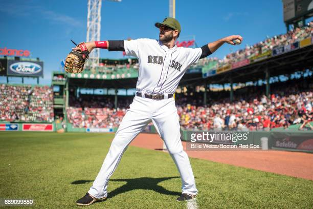 Mitch Moreland of the Boston Red Sox warms up before a game against the Seattle Mariners on May 27 2017 at Fenway Park in Boston Massachusetts MLB...